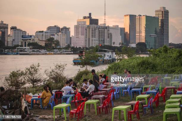 People eat along the Saigon River in Ho Chi Minh city Vietnam on Wednesday Sept 11 2019 Vietnam is the seventhlargest goods exporter to the US...