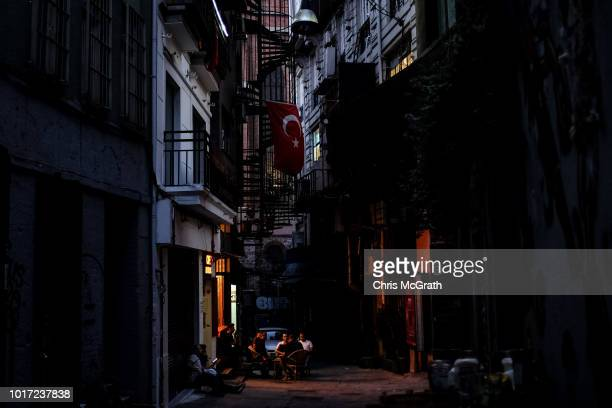 People eat and drink in a street on August 15 2018 in Istanbul Turkey The Turkish Lira recovered to trade at 61 USD despite President Erdogan...