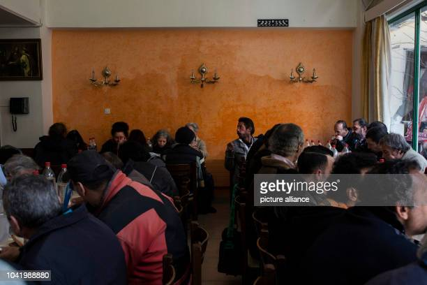 People eat at a soup kitchen run by the Churchrun Galini charities near Athens Greece on March 6 2017 Photo Angelos Tzortzinis/dpa | usage worldwide