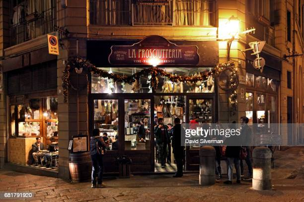 People eat at La Prosciutteria restaurant on March 29 2017 in central Bologna Italy The restaurant which originated in nearby Tuscany and now has...
