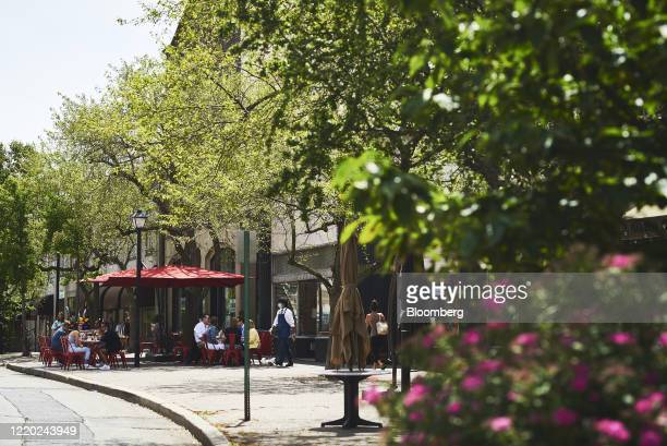 People eat at outdoor seating at a restaurant in Montclair, New Jersey, U.S., on Monday, June 15, 2020. New Jersey enters Phase 2 on Monday, opening...
