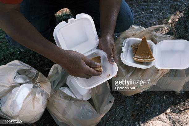 People eat at the annual Thanksgiving in the Park gathering where residents of the farm worker community of Immokalee are provided with a free...