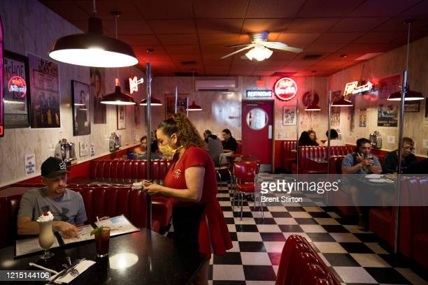People eat at the Busy Bee Diner on May 24, 2020 in Ventura, California. The Busy Bee is one of the many California restaurants that have reopened...