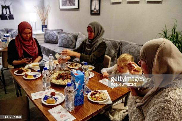 People eat during iftar the meal after sunset on the first day of the Muslim holy month of Ramadan in Rotterdam on May 6 2019 / Netherlands OUT