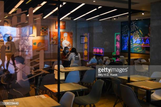 People eat in a restaurant during a coronavirus outbreak on March 26 2020 in Hong Kong China Latest statistics showed Hong Kong tourist arrivals...