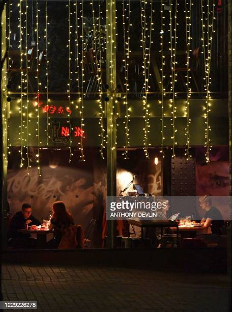 People eat in a restaurant in Manchester city centre northwest England on October 22 2020 ahead of new coronavirus restrictions coming into force...