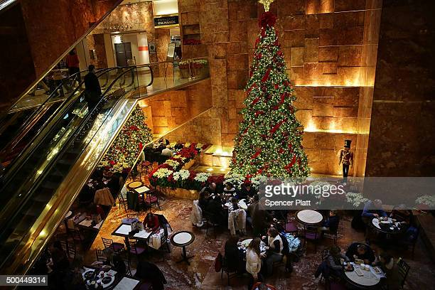 People eat inside of the Trump Tower on December 8 2015 in New York City Donald Trump's latest incendiary remarks concerning Muslims has led to...