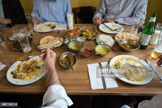 People eat lunch inside the India Club restaurant in London on October 16 2017 Plans to renovate a historic and beloved Indian restaurant in central...