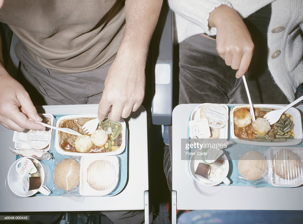 People Eating Airline Food : Stock Photo