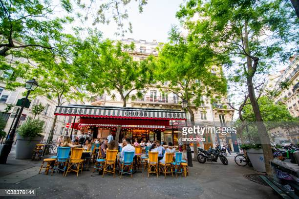 people eating and drinking in paris cafes and restaurants. - brasserie stock photos and pictures