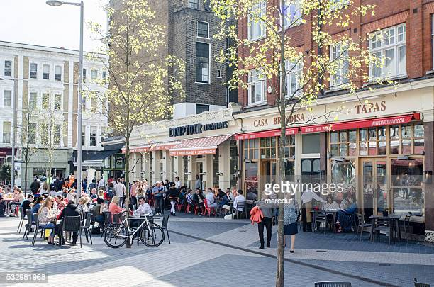 People eating and drinking on Exhibition Road, London