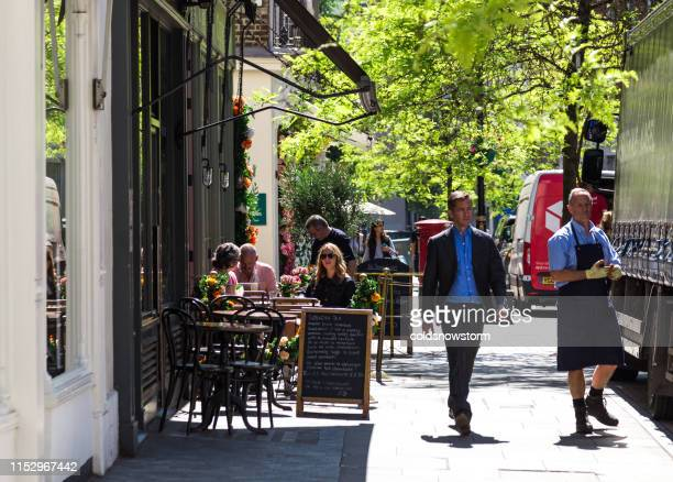 people eating and drinking outside boutique cafe in london, uk - tea room stock pictures, royalty-free photos & images