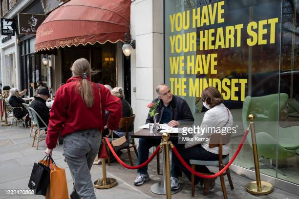 People eating at a restaurant with tables on the pavement on the King's Road in the upmarket area of Chelsea on 14th April 2021 in London, United...