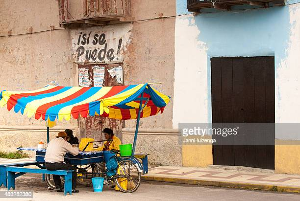 People Eating at Colorful Bike-Propelled Street Food Cart, Puno, Peru