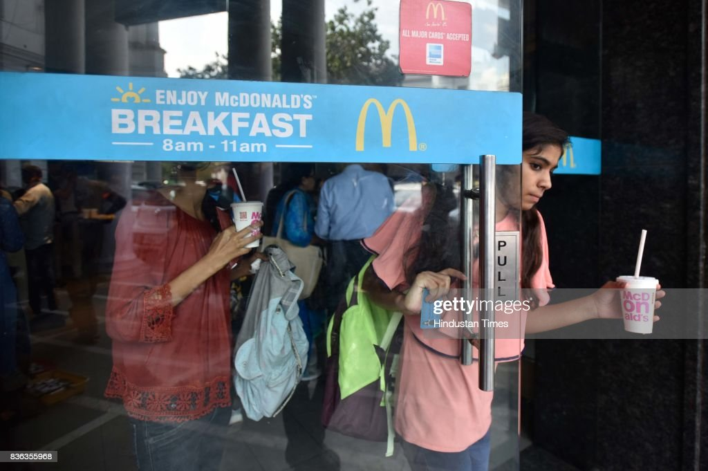 People eating at McDonald's outlet at Connaught Place on August 21, 2017 in New Delhi, India. McDonald's snapped its franchise agreement with Connaught Plaza Restaurants Ltd. (CPRL), its equally owned joint venture with Vikram Bakshi that operated the US chains restaurants in northern and eastern India. McDonald's has taken away all branding, trademark, design and marketing policy rights from CPRL while culminating a 22-year relationship with Bakshi. The decision could impact about 6,500 direct jobs in India, and lead to the possible closure of McDonald's restaurants in the northern and eastern regions, at least temporarily.