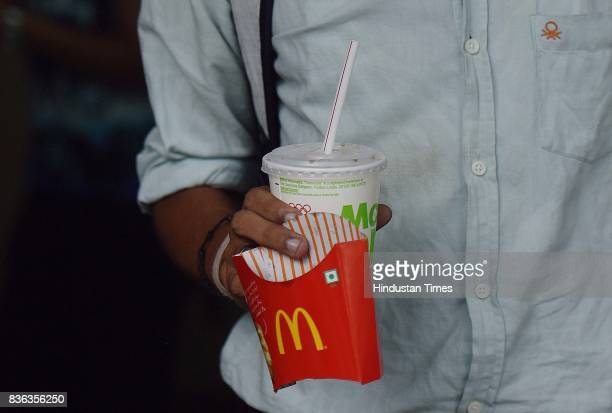 People eating at McDonald's outlet at Connaught Place on August 21 2017 in New Delhi India McDonald's snapped its franchise agreement with Connaught...