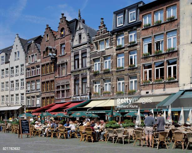 people eating at sidewalk cafes - antwerp city belgium stock pictures, royalty-free photos & images