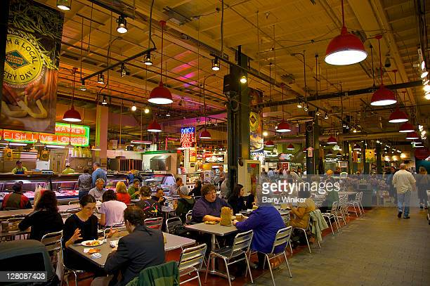 People eating at tables in Reading Terminal Market, first operated in 1892, now bustling in Center City, Philadelphia, Pennyslvania