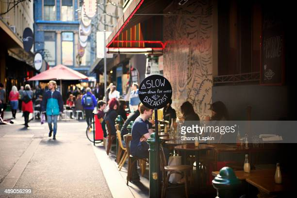 People eating breakfast in Melbourne's iconic innercity Degraves Street