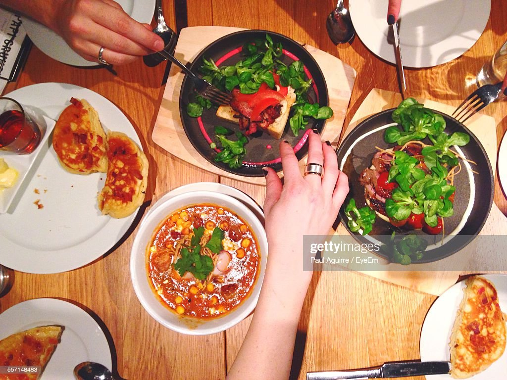 People Eating Dinner At Home : Stock Photo