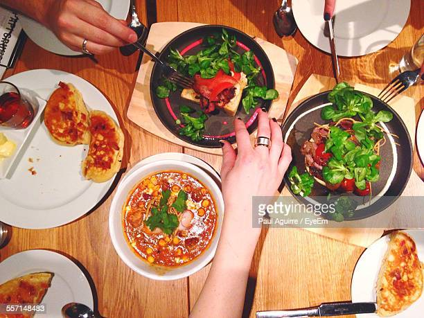 people eating dinner at home - tapas stock photos and pictures