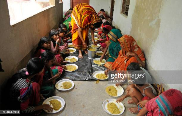 People eating food at relief camp in school in flood affected Chiknan village of Howrah on July 28 2017 near Kolkata India Flood situation in Bengal...