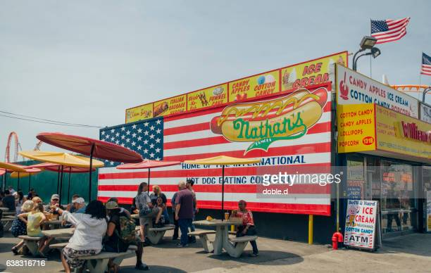 People eating in Nathan's original restaurant at Coney Island