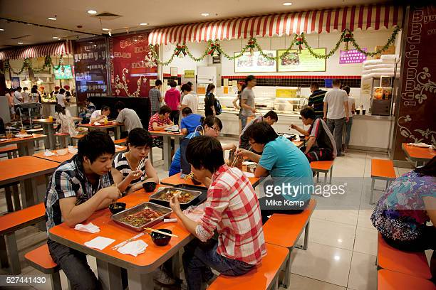 People eating lunch on the canteen food hall floor of the eplaza digital shopping mall Zhongguancun or Zhong Guan Cun is a technology hub in Haidian...
