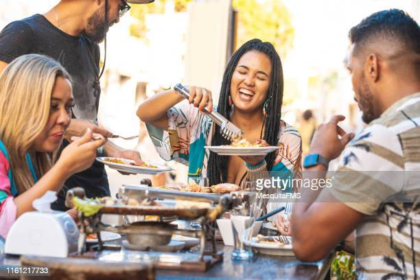 people eating northeastern food in pernambuco state, brazil - porto galinhas stock photos and pictures