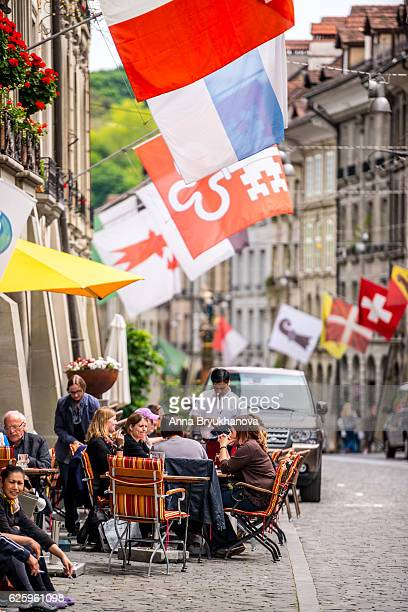 People eating outdoors in a cafe, Bern, Switzerland