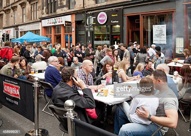 People eating outdoors in Gibson Street, Glasgow