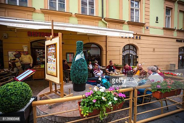 People eating outdoors in Prague