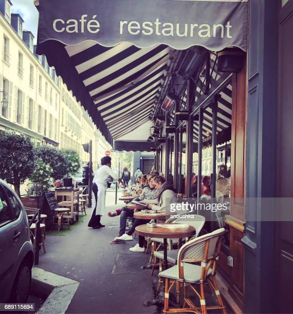 People eating outside in Paris cafe, France