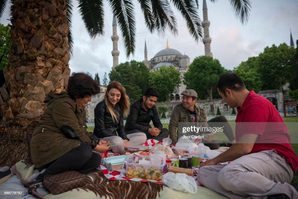 People eating Ramadan iftar meal in Istanbul, Turkey : Stock Photo