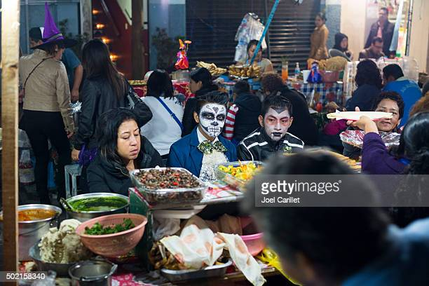 People eating street food - Oaxaca, Mexico