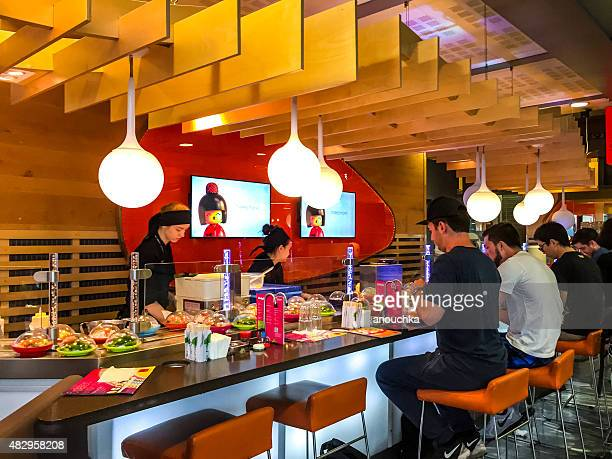 People eating sushi at Oslo Airport, Norway