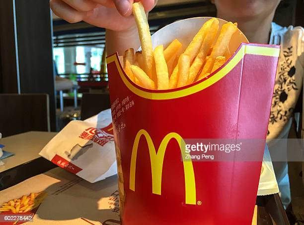 People eats fried chips in a A McDonald's restaurant While Yum brands entered into a deal with Chinese local investors facing a declining trend in...