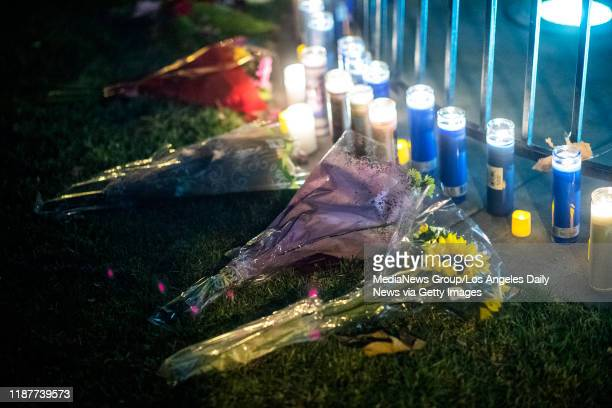 People effected by the Saugus High School shooting leave candles and flowers during vigil at Central Park in Santa Clarita Thursday November 14 2019