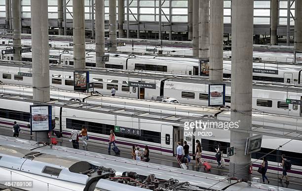People embark onto trains at Madrid's Atocha station on August 21 2015 AFP PHOTO / DANI POZO
