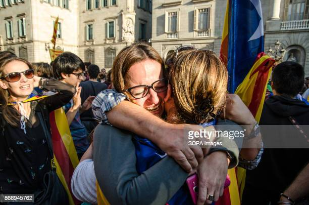 People embrace at the end of the statement of the President Puigdemont as the independence of Catalonia is still possible Students were demonstrating...