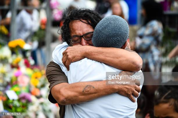 People embrace at the Kilbirnie Mosque on March 17 2019 in Wellington New Zealand 50 people are confirmed dead and 36 are injured still in hospital...