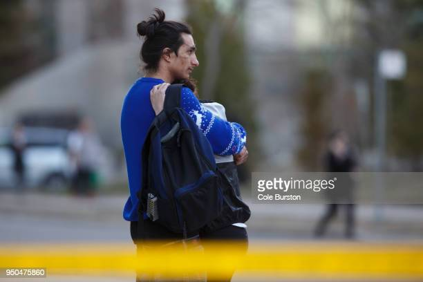 People embrace at the scene on Yonge St at Finch Ave after a van plowed into pedestrians on April 23 2018 in Toronto Canada A suspect identified as...