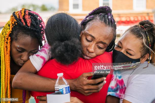 People embrace each other after hearing the sentencing of former Minneapolis police officer Derek Chauvin on June 25, 2021 in Minneapolis, Minnesota....