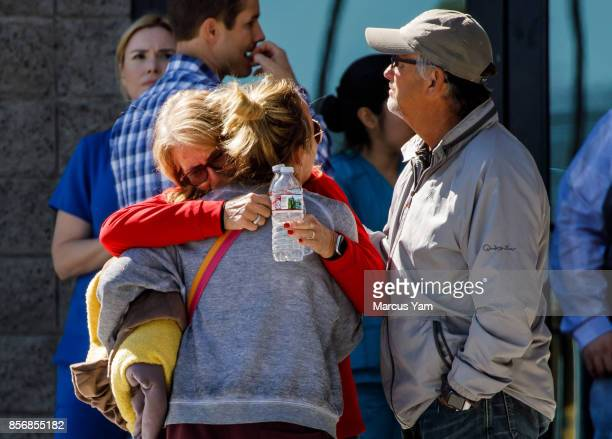 People embrace each other outside a family assistance center in Las Vegas Nevada on Oct 2 2017 after the recent mass shooting that killed more than...
