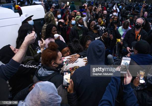 People embrace Katie Wright , mother of Daunte Wright, as demonstrators gathered on April 11, 2021 in Brooklyn Center, Minnesota. Protesters took to...