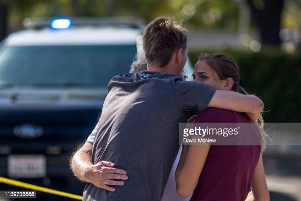People embrace outside the Congregation Chabad synagogue on April 27 2019 in Poway California A gunman opened fire at the synagogue on the last day...