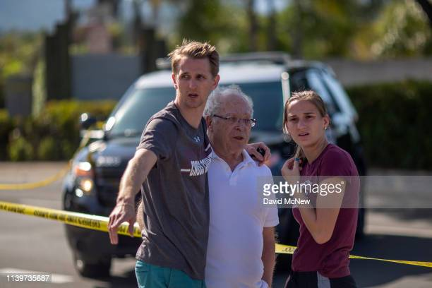 People embrace outside the Congregation Chabad synagogue on April 27, 2019 in Poway, California. A gunman opened fire at the synagogue on the last...