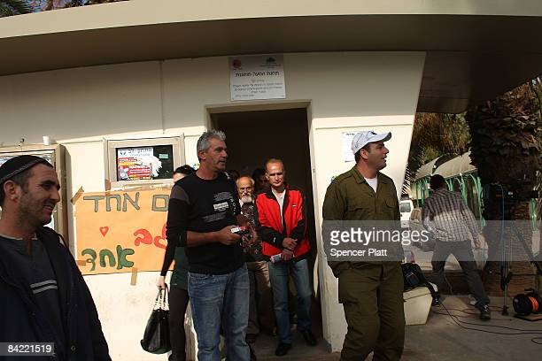 People emerge from a bomb shelter January 9, 2009 in Sderot, Israel. The southern town of Sderot has had hundreds of Hamas fired kassam rockets...