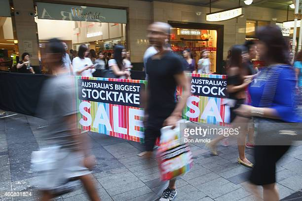 People emerge from the Myer store in Pitt St during the Boxing Day Sales on December 26 2014 in Sydney Australia