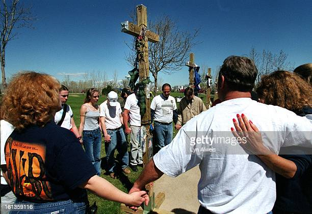 People encircled each of the 13 crosses seperately and prayed The crosses were brought to Clement Park by Greg Zanis from Aurora Illinois The same...